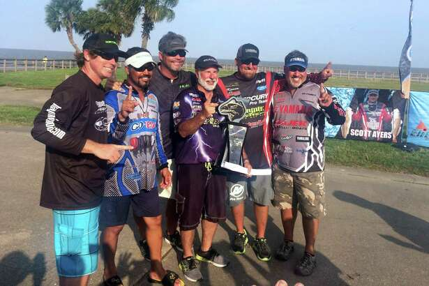 Charlie Barton, middle, of Port Lavaca won the Elite Redfish Series by 0.81 of a pound on Saturday, April 30, 2016, after weather conditions made fishing rough throughout the event in Port Arthur. (Brooks Kubena/The Enterprise)