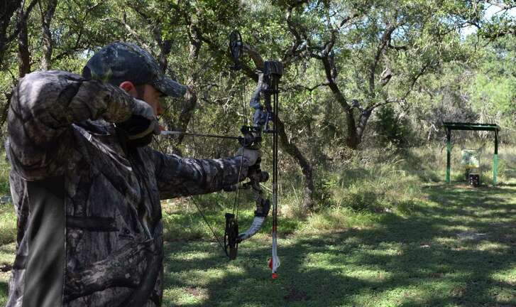 Taking a few practice shots with his bow, Kenneth Roberts of the Nooner Ranch near D'Hanis is an avid archery hunter who takes advantage of the early season opportunity to check out range and animal conditions each year.
