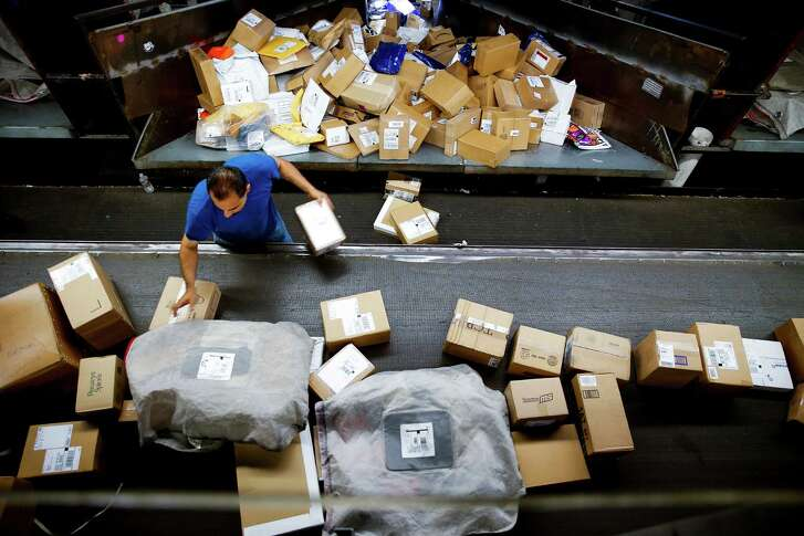 A UPS worker sorts packages at the UPS Sweetwater hub Wednesday, Oct. 12, 2016 in Houston. ( Michael Ciaglo / Houston Chronicle )