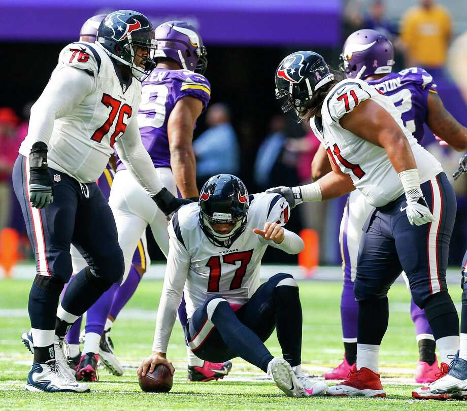 Houston Texans tackle Duane Brown (76) and guard Xavier Su'a-Filo (71) pick quarterback Brock Osweiler (17) up off the field after he was sacked by Minnesota Vikings defensive end Danielle Hunter during the second half of an NFL football game at U.S. Bank Stadium on Sunday, Oct. 9, 2016, in Minneapolis. ( Brett Coomer / Houston Chronicle ) Photo: Brett Coomer, Staff / © 2016 Houston Chronicle