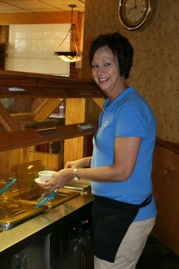 Server Connie Tschirhart gets some soup from one of the bars at the Peppermill, which was voted the best place to get a bowl of soup. No. 2 was Shelly's Bar & Grill, and No. 3 was Big Boy. Photo: Unknown, Tribune File Photo
