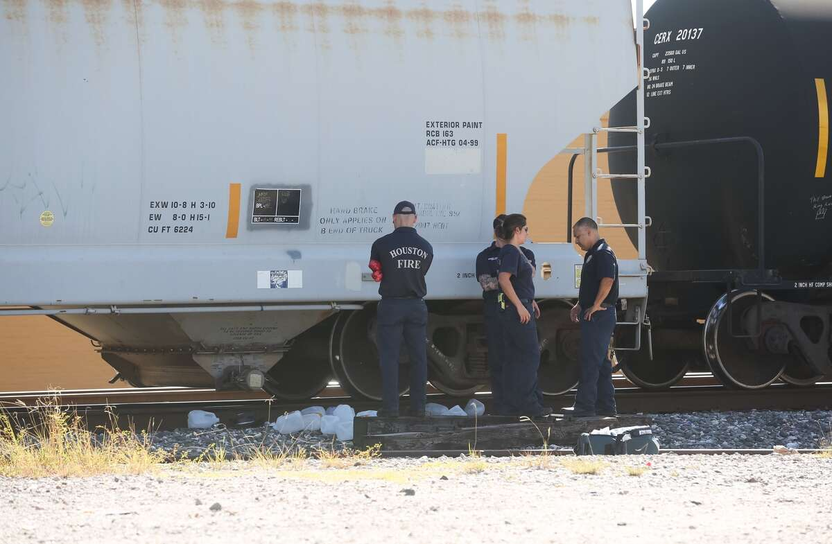 Authorities investigate where a man was hit by a train in the 5800 block of Lyons Ave., Thursday, Oct. 13, 2016, in Houston. The man was taken to Ben Taub Hospital. ( Jon Shapley / Houston Chronicle )