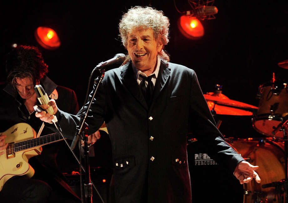FILE  - In this Jan. 12, 2012, file photo, Bob Dylan performs in Los Angeles. Dylan was named the winner of the 2016 Nobel Prize in literature Thursday, Oct. 13, 2016, in a stunning announcement that for the first time bestowed the prestigious award to someone primarily seen as a musician. (AP Photo/Chris Pizzello, File) Photo: Chris Pizzello, STF / AP2012