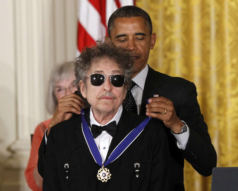 In 2012, President Obama presented Dylan with a Medal of Freedom. Dylan looked pained. Photo: Charles Dharapak, STF / Copyright 2012 The Associated Press. All rights reserved. This material may not be published, broadcast, rewritten or redistribu