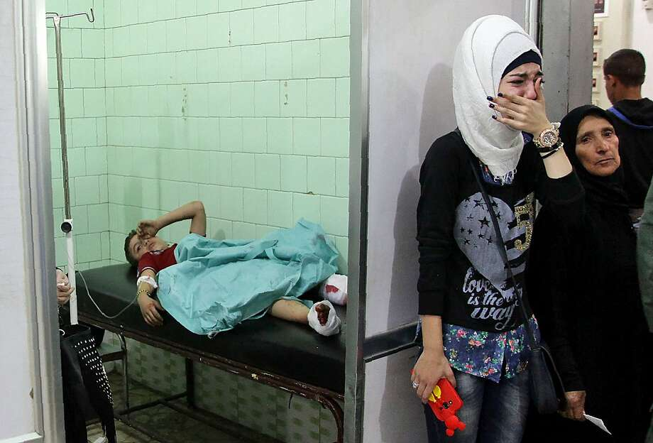 A boy receives treatment at a hospital in Aleppo. Unabating violence in the city has given additional urgency to a U.S.-Russia meeting on Saturday. Photo: GEORGE OURFALIAN, AFP/Getty Images