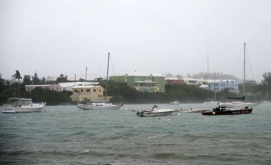 Heavy rain and increasing winds rock boats moored in Mullet Bay in St. Georges, Bermuda, Thursday, Oct. 13, 2016 as the island begins to feel the effects of Hurricane Nicole. The hurricane had strengthened to a Category 4 storm late Wednesday but lost some steam overnight. However, forecasters warned that it was still extremely dangerous. (AP Photo/Mark Tatem) Photo: Mark Tatem, Associated Press