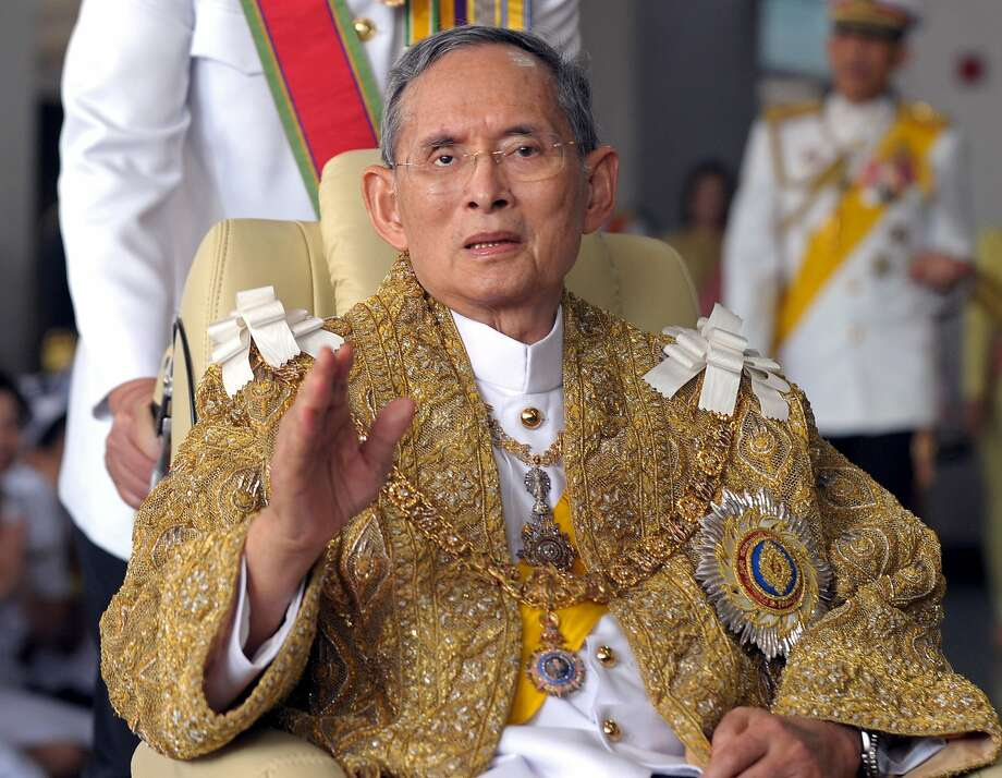 King Bhumibol Adulyadej waves to well-wishers after the royal ceremony for his 83rd birthday in Bangkok. Photo: PORNCHAI KITTIWONGSAKUL, AFP/Getty Images