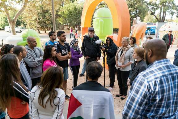 Runners gather at Google's Headquarters in Mountain View, Calif. to deliver a letter to a representative regarding the lack of recognition of 150 cities along the West Bank on Google Maps on Thursday, Oct. 13, 2016. The runners are protesting the roughly 150 cities on the West Bank that do not appear on Google or Apple maps.