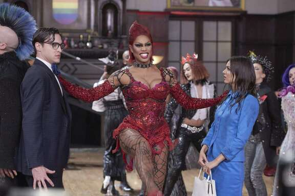 Laverne Cox (center), flanked by Ryan McCartan and Victoria Justice, plays Dr. Frank N Furter in the remake.