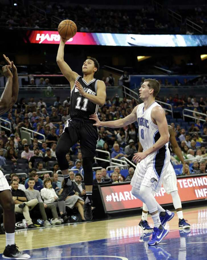 Spurs' Bryn Forbes takes a shot as he gets past the Magic's Mario Hezonja during the second half of a preseason game on Oct. 12, 2016, in Orlando, Fla.