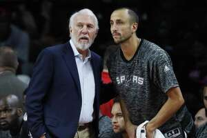 Spurs head coach Gregg Popovich talks with San guard Manu Ginobili in the first half of a preseason game in against Detroit Auburn Hills, Mich., on Oct. 10, 2016.