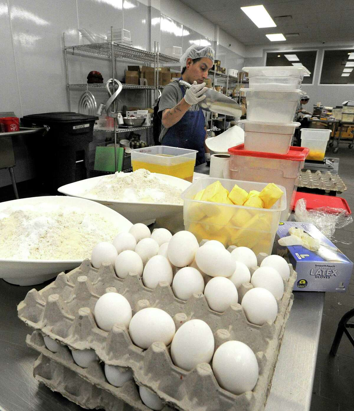 Ruben Martinez prepares ingredients for tasty gluten free kosher bakery goods at By The Way Bakery new state of the art facility in Pleasantville, New York on Tuesday, Oct. 11, 2016.