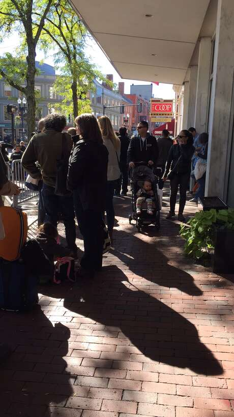 The store sign is finally in sight as the line moves for Bruce Springsteen at Harvard Coop Bookstore, Cambridge, Mass. on October 10, 2016.  (Joyce Bassett / Times Union)