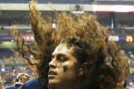 UTSA's Josiah Tauaefa on the sidelines during the Southern Miss game at the Alamodome on Oct. 8, 2016