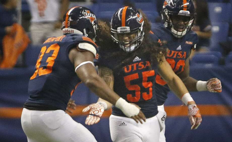 UTSA's Josiah Tauaefa (55) celebrates his interception with Marcus Davenport against Southern Mississippi at the Alamodome on Oct. 8, 2016, in San Antonio. Photo: Ron Cortes /For The Express-News / The San Antonio Express-News