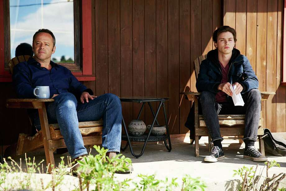 Gil Bellows (left) plays the father of a teen, played by Tyler Young, who wit nesses a double killing but fears speaking up because it would reveal he is gay. Photo: USA Network / Shane Mahood/USA Network / 2016 USA Network Media, LLC