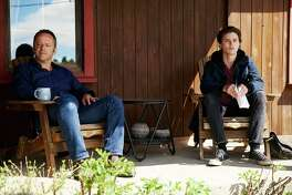 Gil Bellows (left) plays the father of a teen, played by Tyler Young, who wit nesses a double killing but fears speaking up because it would reveal he is gay.