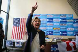 U.S. Democratic Presidential nominee Hillary Clinton waves goodbye to supporters after an event at the DNC headquarters on Van Ness Avenue in San Francisco, California, on Thursday, Oct. 13, 2016.
