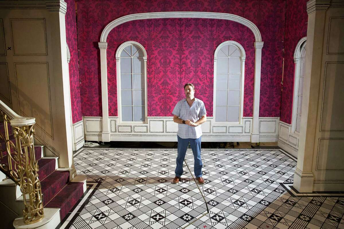 Houston Ballet Director of Production Andrew Nielsen poses for a photo with the brand new sets of its upcoming