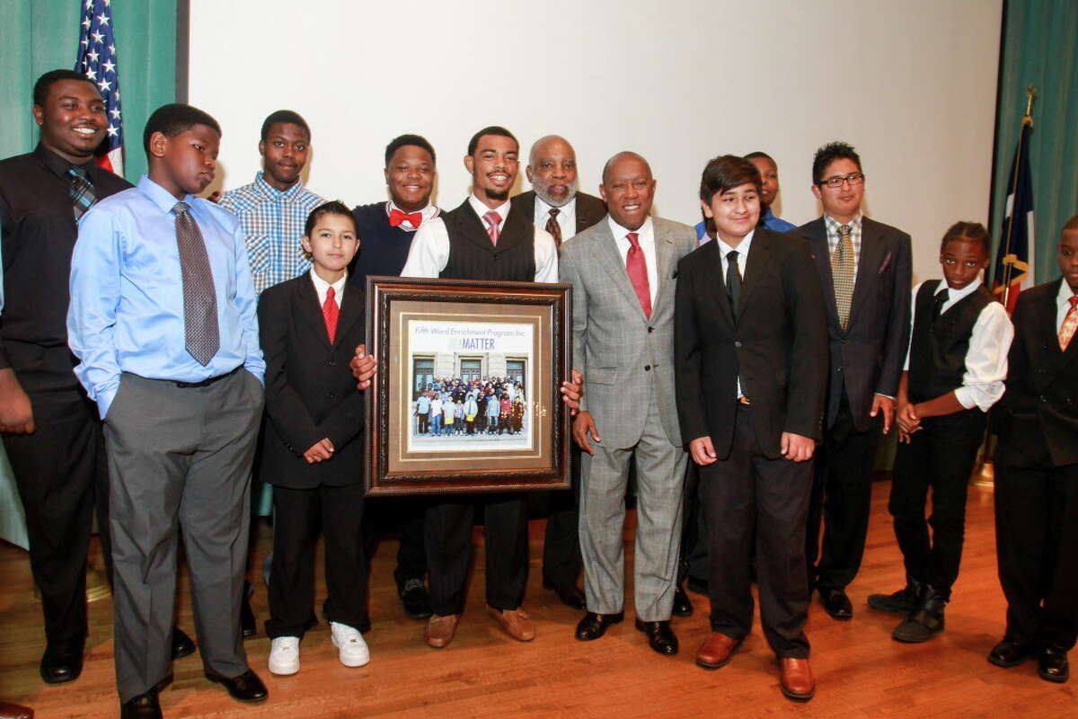 Mayor Sylvester Turner and the FWEP participants with a photo of the group they gave him at the Fifth Ward Enrichment Program's 15th annual luncheon. (For the Chronicle/Gary Fountain, October 13, 2016)
