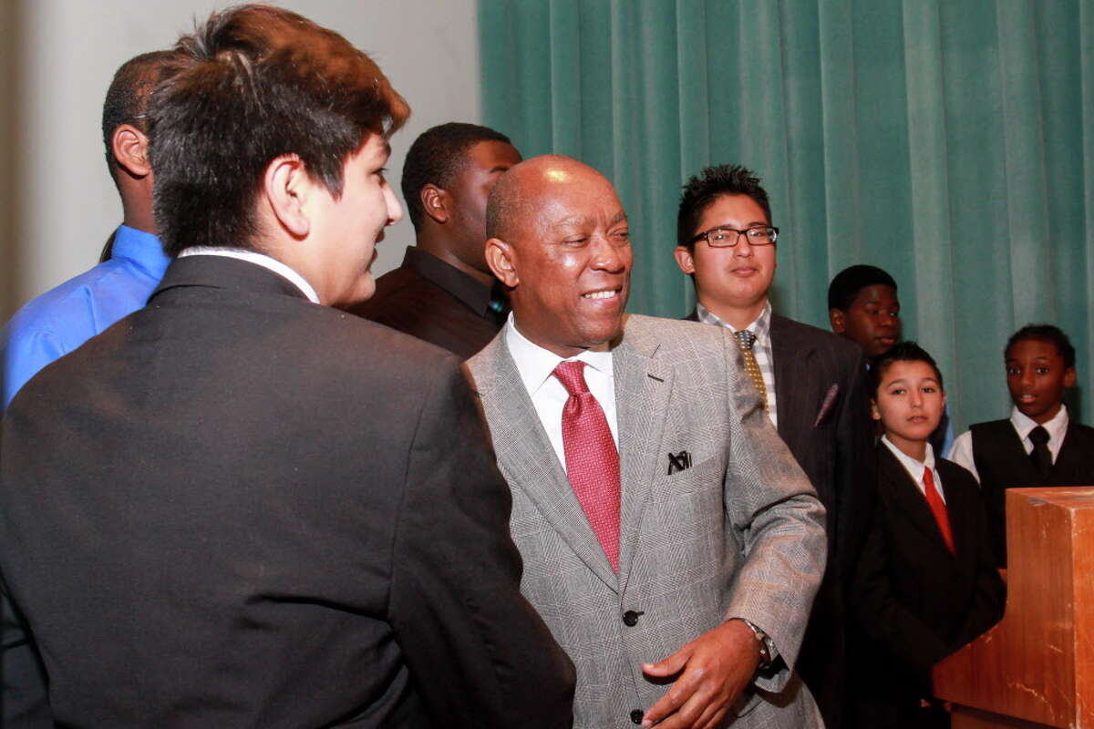 Mayor Sylvester Turner meeting FWEP participants at the Fifth Ward Enrichment Program's 15th annual luncheon. (For the Chronicle/Gary Fountain, October 13, 2016)