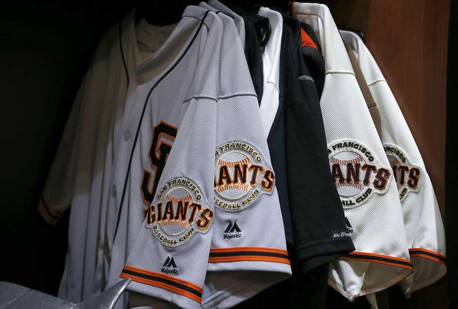 Madison Bumgarner's uniforms still hang from his locker in the Giants clubhouse at AT&T Park in San Francisco, Calif. on Thursday, Oct. 13, 2016, two days after the team was eliminated in the NLDS by the Chicago Cubs. Photo: Paul Chinn, The Chronicle