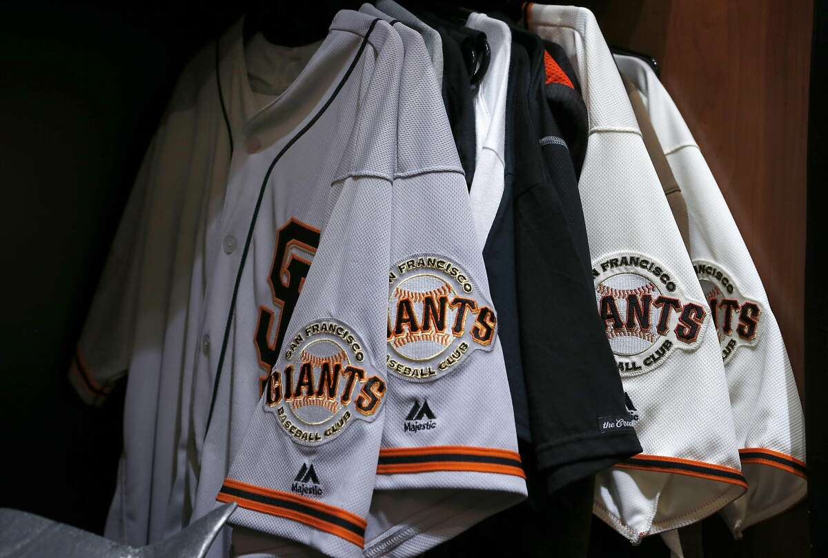 Madison Bumgarner's uniforms still hang from his locker in the Giants clubhouse at AT&T Park in San Francisco, Calif. on Thursday, Oct. 13, 2016, two days after the team was eliminated in the NLDS by the Chicago Cubs.