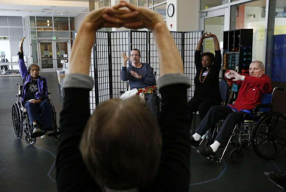 From left, Lucille Atkinson, 83, Matthew Heija, 63, Wellness Center staffer Cynthia Madonna and David Albright, 70, follow Instructor Elvia Perez, front center, as she leads a class in Qigong at Laguna Honda Hospital and Rehabilitation Center Oct. 13, 2016 in San Francisco, Calif. Photo: Leah Millis, The Chronicle