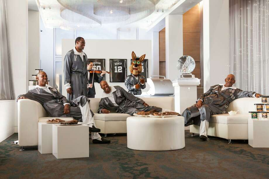 "In an H-E-B commercial slated to air in late October 2016, retired power forward Tim Duncan is invited to a ""secret retirement club"" with former players David Robinson, George Gervin, Bruce Bowen and Sean Elliott all lounging around in black slippers and silver robes. Photo: Courtesy /H-E-B / Courtesy /H-E-B"