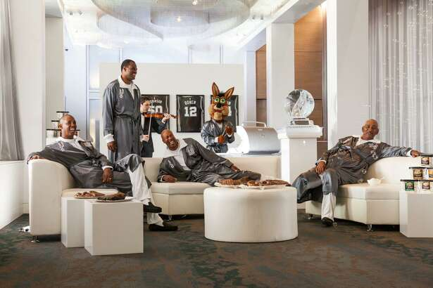 Former Spurs players David Robinson, George Gervin, Bruce Bowen and Sean Elliott lounge around in black slippers and silver robes on the set of an H-E-B commercial slated to air in late October 2016.