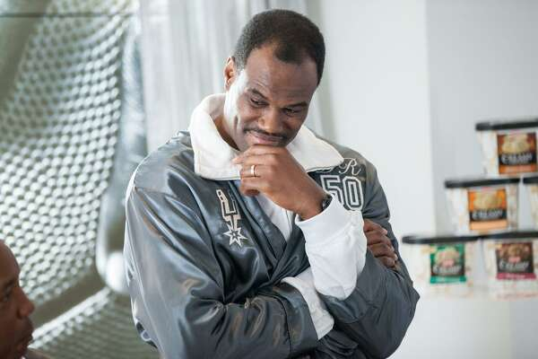 """Former Spurs player David Robinson on the set of an H-E-B commercial slated to air in late October 2016. In the commercial, retired power forward Tim Duncan is invited to a """"secret retirement club"""" with Robinson, George Gervin, Bruce Bowen and Sean Elliott all lounging around in black slippers and silver robes."""