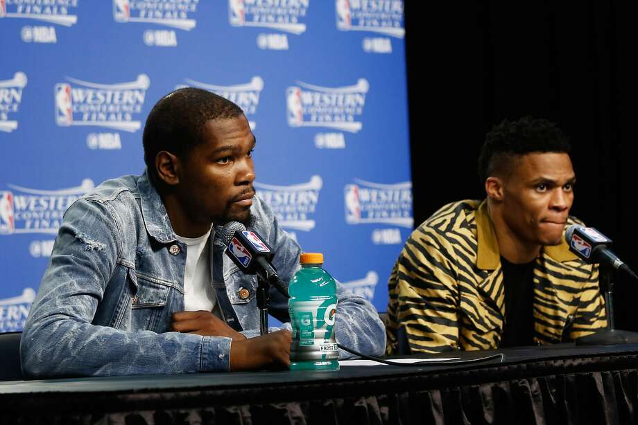 Kevin Durant #35 of the Oklahoma City Thunder (L) and Russell Westbrook #0 look on during a press conference after the Golden State Warriors defeated the Oklahoma City Thunder 108-101 in game six of the Western Conference Finals during the 2016 NBA Playoffs at Chesapeake Energy Arena on May 28, 2016 in Oklahoma City, Oklahoma. Photo: J Pat Carter, Getty Images