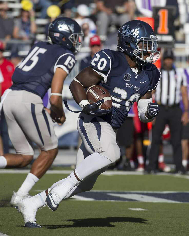 Nevada's James Butler runs against Fresno State in the first quarter of an NCAA college football game in Reno, Nev., on Saturday, Oct. 8, 2016. (AP Photo/Tom R. Smedes) Photo: Tom R. Smedes, Associated Press