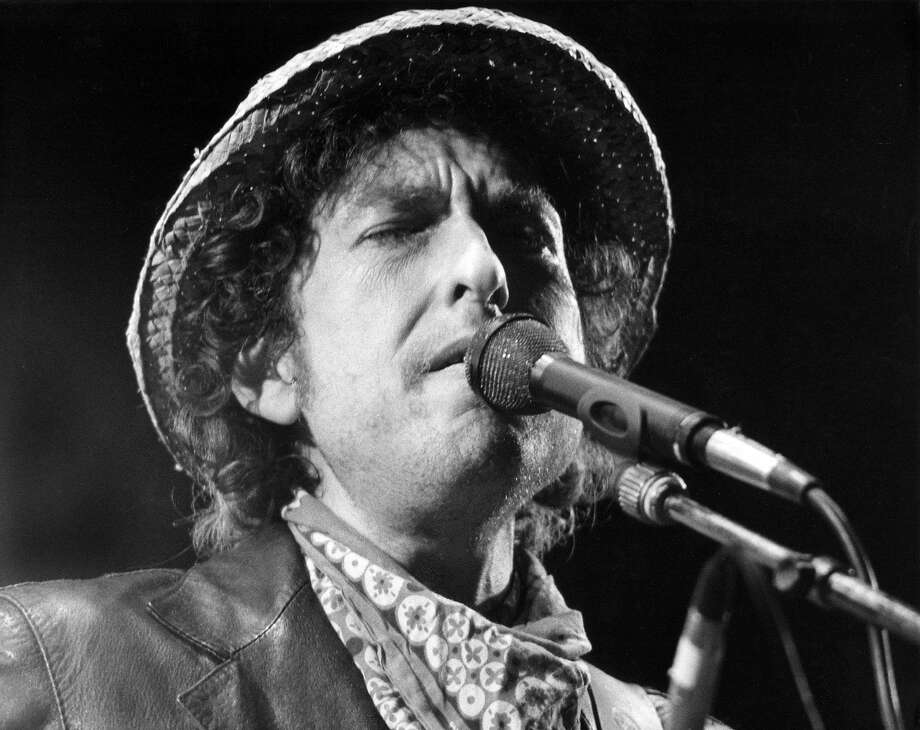 Bob Dylan performs at a concert at the Olympic stadium in Munich, Germany, in 1984. Photo: ISTVAN BAJZAT, AFP/Getty Images