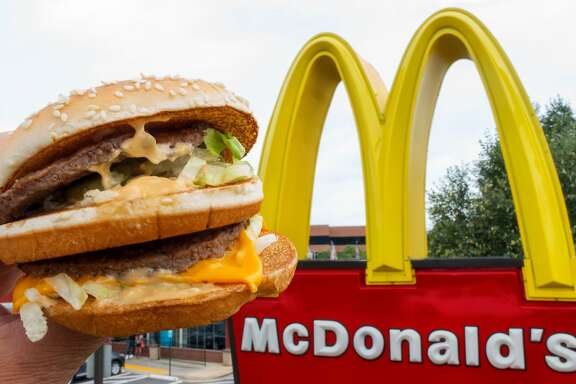 (FILES) This file photo taken on August 10, 2015 shows a McDonald's Big Mac, held up near the golden arches at a McDonalds's  in Centreville, Virginia.       McDonald's said March 31, 2016 it plans to open more than 1,500 restaurants in China, Hong Kong and South Korea over the next five years and wants partners in the Asia expansion. The US fast-food giant has more than 2,800 restaurants in the three markets, most of which are company-owned. Worldwide, more than 80 percent are owned and operated by independent local people, and the company's long-term goal is to be 95 percent franchised.  / AFP PHOTO / PAUL J. RICHARDSPAUL J. RICHARDS/AFP/Getty Images