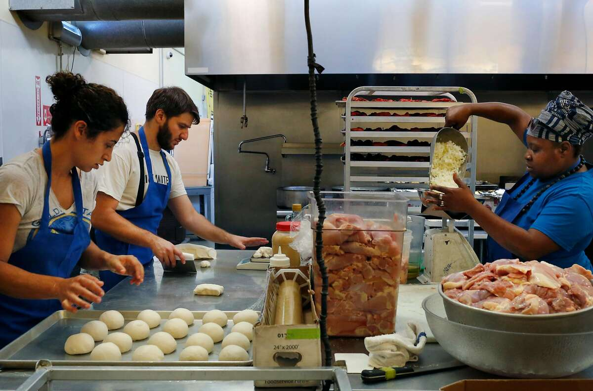 Reem Assil, left, Eli Isaacs and Wanda Kruda work on food prep for the week during production day at La Cocina Community Kitchen Oct. 11, 2016 in San Francisco, Calif.