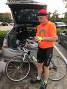 Randall Cade, an avid cyclist in The Woodlands, prepares for a ride with columnist Mike Snyder