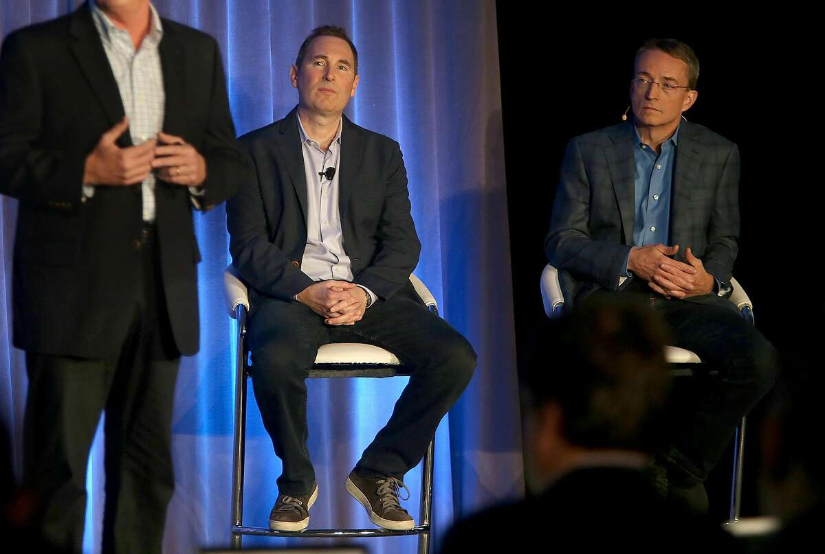 Western Digital CIO Steven Phillpott (left) speaks with CEO Andy Jassy (middle) and VMware CEO Parick P. Gelsinger (right) during a press conference announcing Amazon's cloud service, AWS, partnering with VMware Cloud creating a new integrated cloud service on Thursday, October 13, 2016, in San Francisco, Calif.