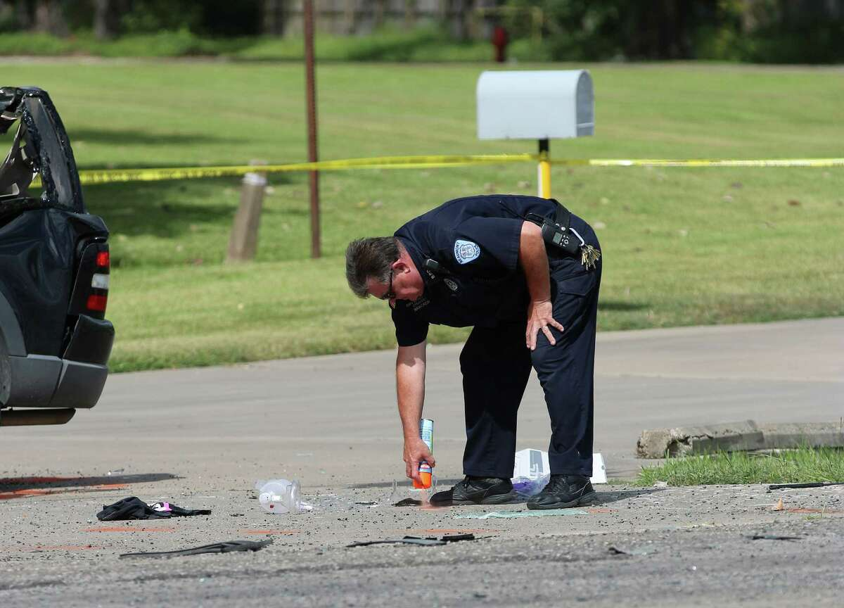 Liberty police use spray paint to mark debris from a fatal accident that took place on Wednesday, Oct. 12.