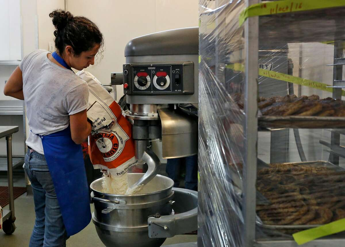 Reem Assil prepares dough during production day for Reem's at La Cocina Community Kitchen Oct. 11, 2016 in San Francisco, Calif.