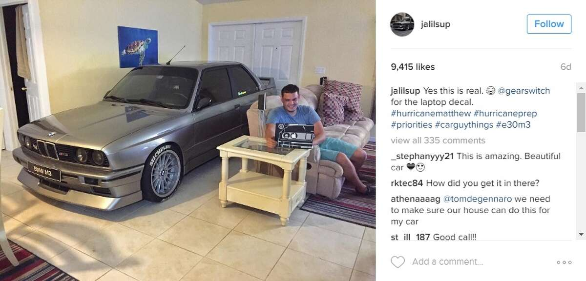 Randy Jalil, of Port St. Lucie, Fla., wasn't going to let Hurricane Matthew ruin his BMW. Image via Instagram