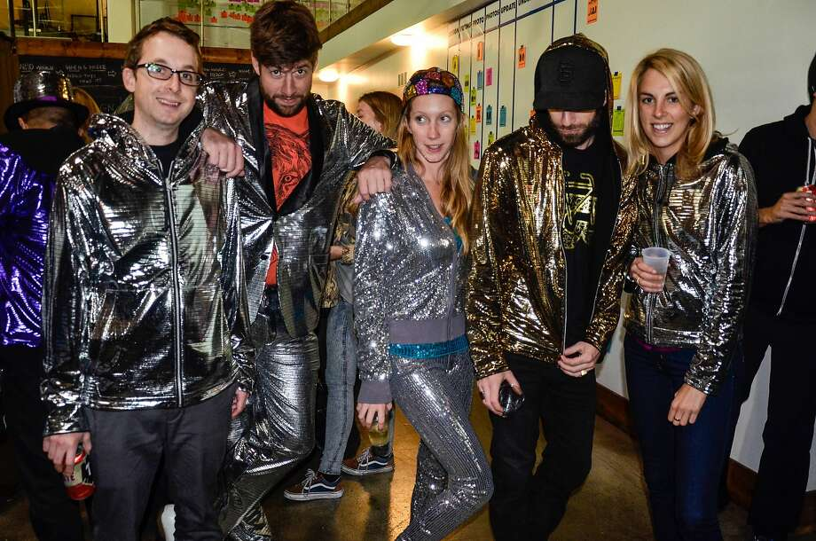 Die-hard fans of Betabrand's disco-patterned fabric gather at Betabrand headquarters at 780 Valencia in San Francisco on Oct. 24 for DiscoCon. Betabrand, a San Francisco apparel company, has a wide range of products but has found the people who adore the disco apparel and fabric are particularly fervent. Photo: Michele Ochoa, Courtesy