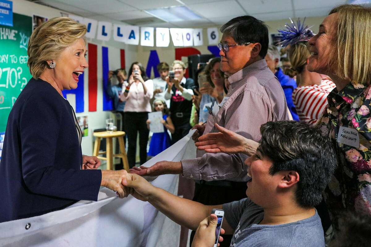 U.S. Democratic Presidential nominee Hillary Clinton greets supporters at an event at the DNC headquarters on Van Ness Avenue in San Francisco, California, on Thursday, Oct. 13, 2016.