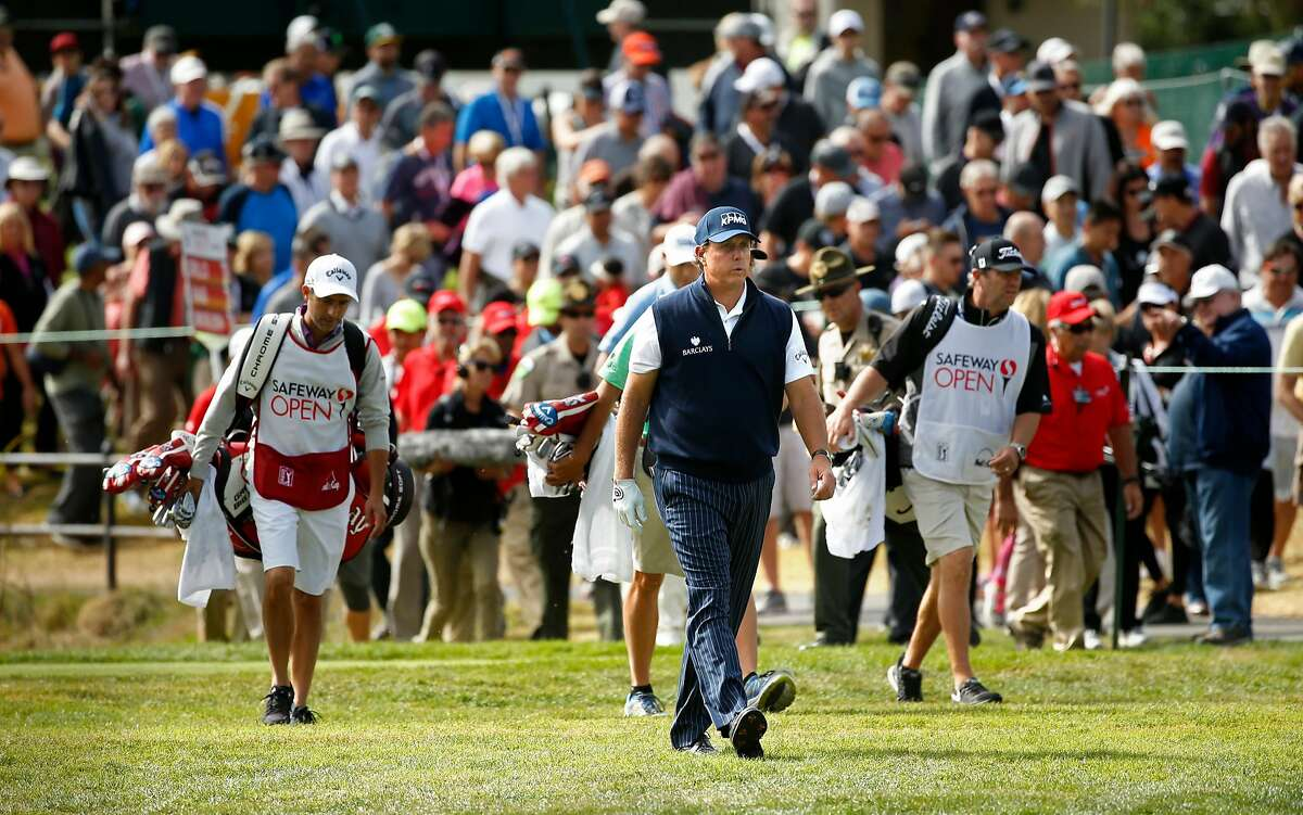 Phil Mickelson with a gallery in tow makes his way up the 1st hole fairway on the 1st hole during round 1 of the Safeway Open golf tournament at the Silverado Resort in Napa, California, on Thursday October 13, 2016