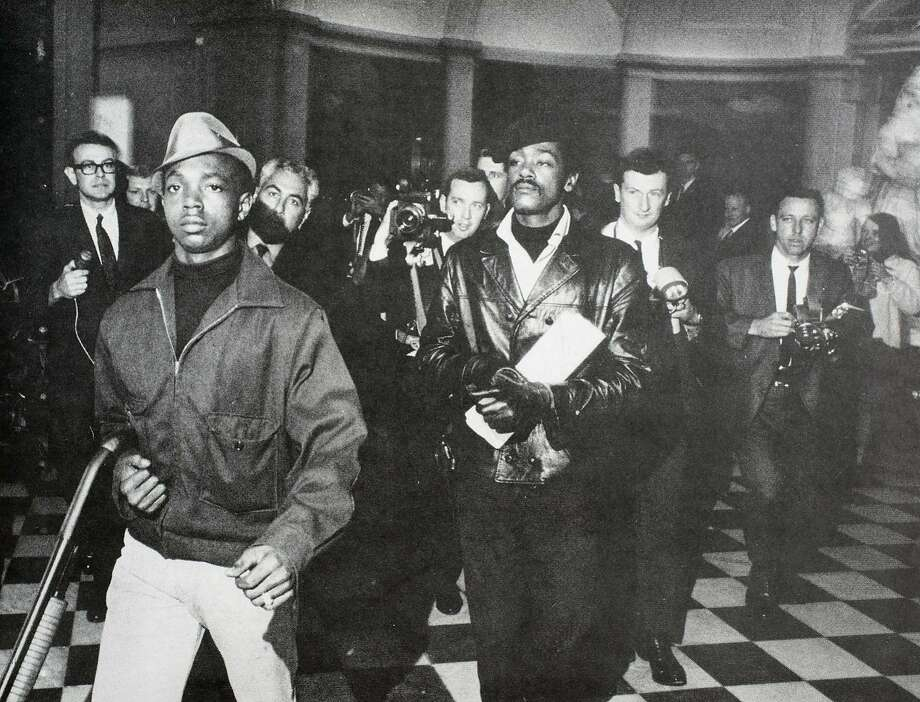 Bobby Hutton and Bobby Seale lead a contingent of Black Panthers carrying loaded rifles in a provocative protest at the state Capitol in Sacramento in May 1967, just months after bursting onto the civil rights scene. Photo: Wade Sharrer/Sacramento Bee