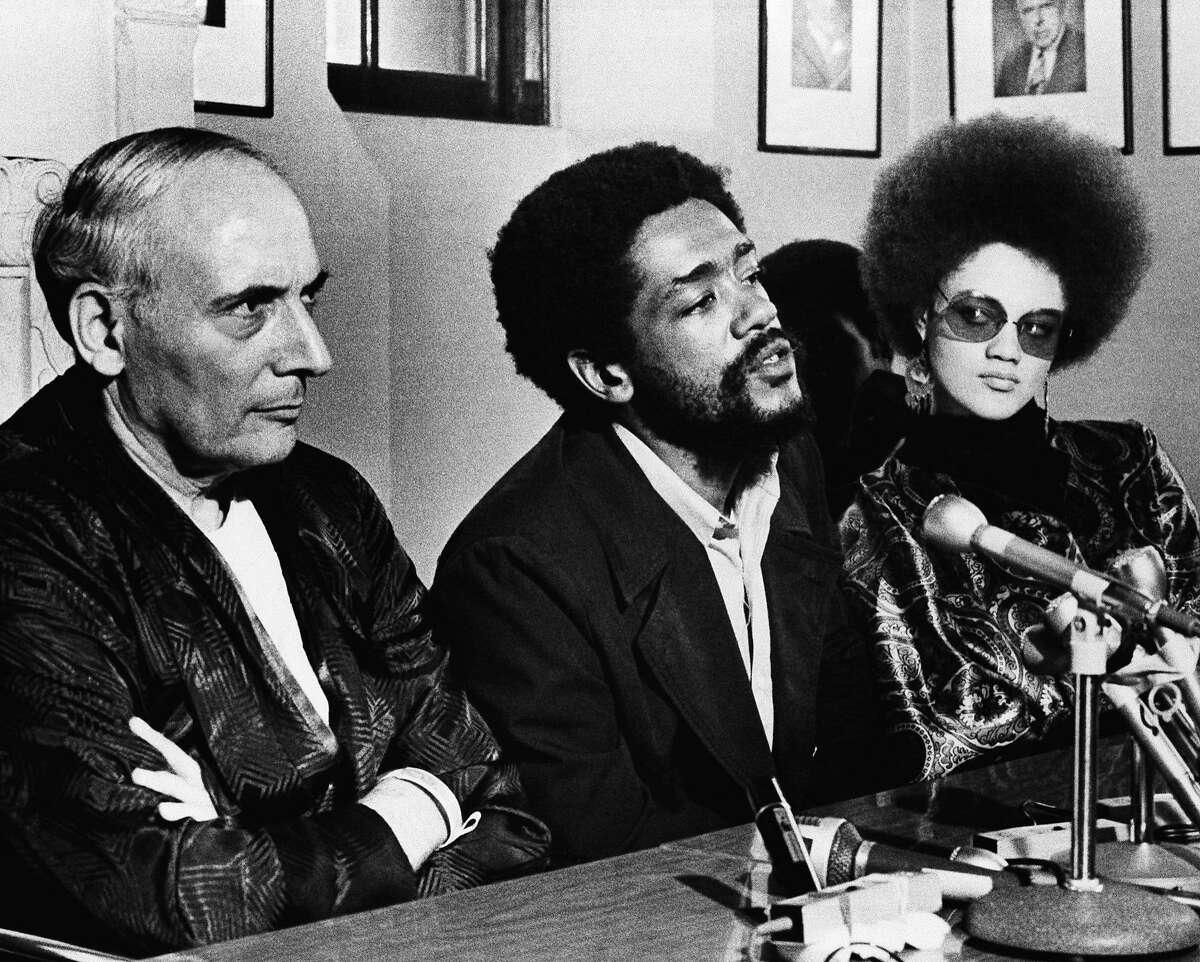 Charles R. Garry, left, Black Panther attorney, accused San Francisco Mayor Joseph Alioto of provoking incidents that led to disorders in the Black Fillmore district in San Francisco, Monday, April 29, 1969. Garry, in a wheel chair at Mt. Zion Hospital where he will undergo surgery, is shown at press conference with Black Panther Bobby Seale, minister of information, and Kathleen Cleaver. (AP Photo/Ernest Bennett)