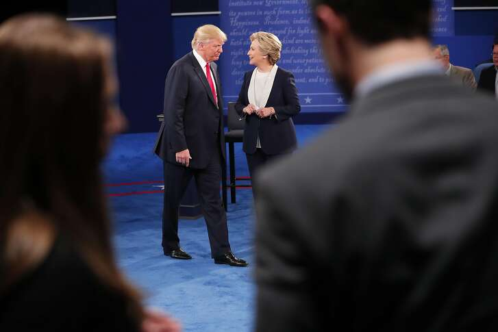 FILE -- Hillary Clinton and Donald Trump during their second presidential debate at Washington University in St. Louis, Oct, 9, 2016. On a conference call with the Republican conference, House Speaker Paul Ryan (R-Wis.) on Monday, urged his members to focus on their own re-election campaigns and to make individual decisions about how to handle Trump, according to two people who were on the call, who spoke on condition of anonymity. (Doug Mills/The New York Times)