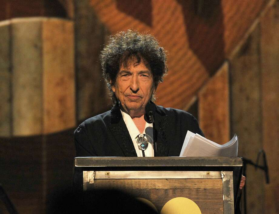 LOS ANGELES, CA - FEBRUARY 06:  Honoree Bob Dylan speaks onstage at the 25th anniversary MusiCares 2015 Person Of The Year Gala honoring Bob Dylan at the Los Angeles Convention Center on February 6, 2015 in Los Angeles, California. The annual benefit raises critical funds for MusiCares' Emergency Financial Assistance and Addiction Recovery programs. For more information visit musicares.org.  (Photo by Lester Cohen/WireImage) Photo: Lester Cohen, WireImage
