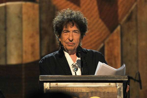 LOS ANGELES, CA - FEBRUARY 06:  Honoree Bob Dylan speaks onstage at the 25th anniversary MusiCares 2015 Person Of The Year Gala honoring Bob Dylan at the Los Angeles Convention Center on February 6, 2015 in Los Angeles, California. The annual benefit raises critical funds for MusiCares' Emergency Financial Assistance and Addiction Recovery programs. For more information visit musicares.org.  (Photo by Lester Cohen/WireImage)