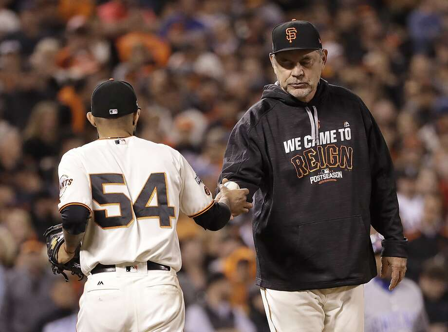 Giants manager Bruce Bochy takes the ball from pitcher Sergio Romo, who likely had just thrown his last pitch as a Giant during the ninth inning of Game 4. Photo: Marcio Jose Sanchez, Associated Press